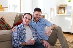 Men couple gay sitting in lounge